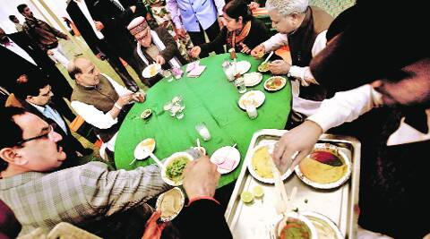 Senior BJP leaders having lunch at the party headquarters on Saturday ahead of a press conference. Praveen Khanna