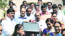 Mayor B S Satyanarayana arrives with the BBMP budget in Bangalore Monday.