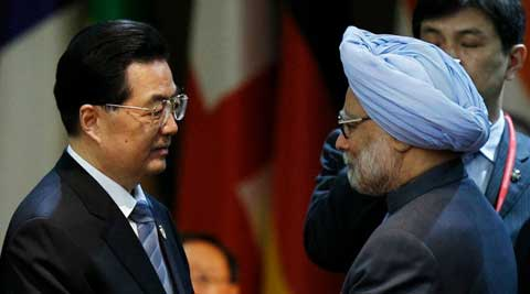 Prime Minister Manmohan singh meets ex-Chinese President Hu Jintao. (Reuters)