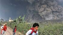 Villagers flee as Mount Sinabung releases pyroclastic flows during an eruption in Indonesia. (AP)