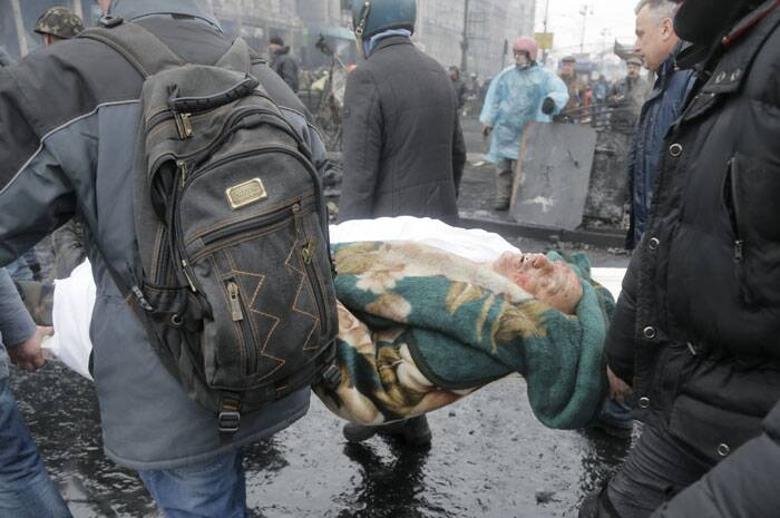 Protesters across the country are also upset over corruption in Ukraine, the lack of democratic rights and the country's ailing economy, which just barely avoided bankruptcy with a $15 billion aid infusion from Russia. <br /> Activists evacuate a protester killed during clashes with police in Kiev's Independence Square, the epicenter of the country's current unrest. (AP)