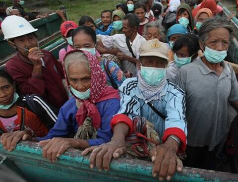 Villagers evacuate from their homes on the slope of Mount Kelud which erupted in Blitar, Indonesia, Friday, Feb 14, 2014.