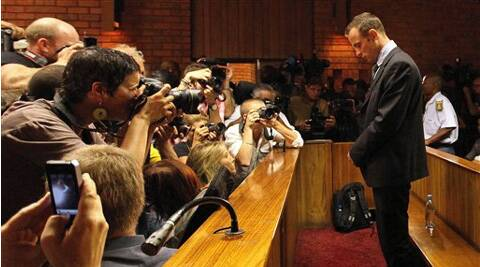 Olympic athlete Oscar Pistorius stands inside a court during his bail hearing at the magistrate court in Pretoria, South Africa. (AP)
