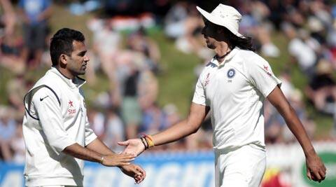 Ishant Sharma leaves the field with Zaheer Khan (L) after taking six wickets in the first innings against New Zealand (Reuters)