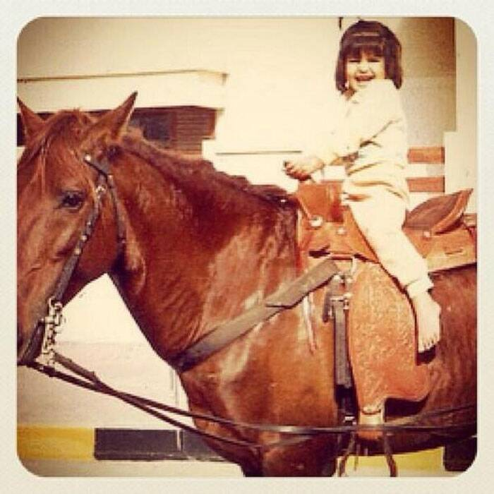 Diva Jacqueline Fernandez was super cute in her childhood. She had front fringes and loved horse riding.