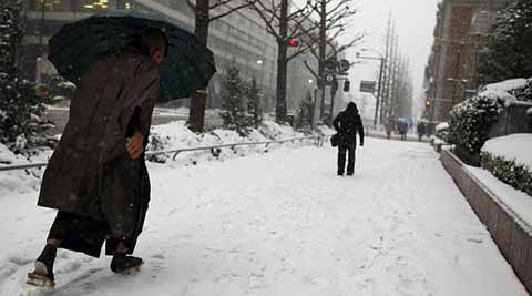 As much as 10.6 inches of snow was recorded in Tokyo by late Saturday, the heaviest fall in the capital for 45 years, according to meteorologists. (AP)