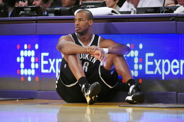 Jason Collins waits to enter the game against the Los Angeles Lakers during the second half at Staples