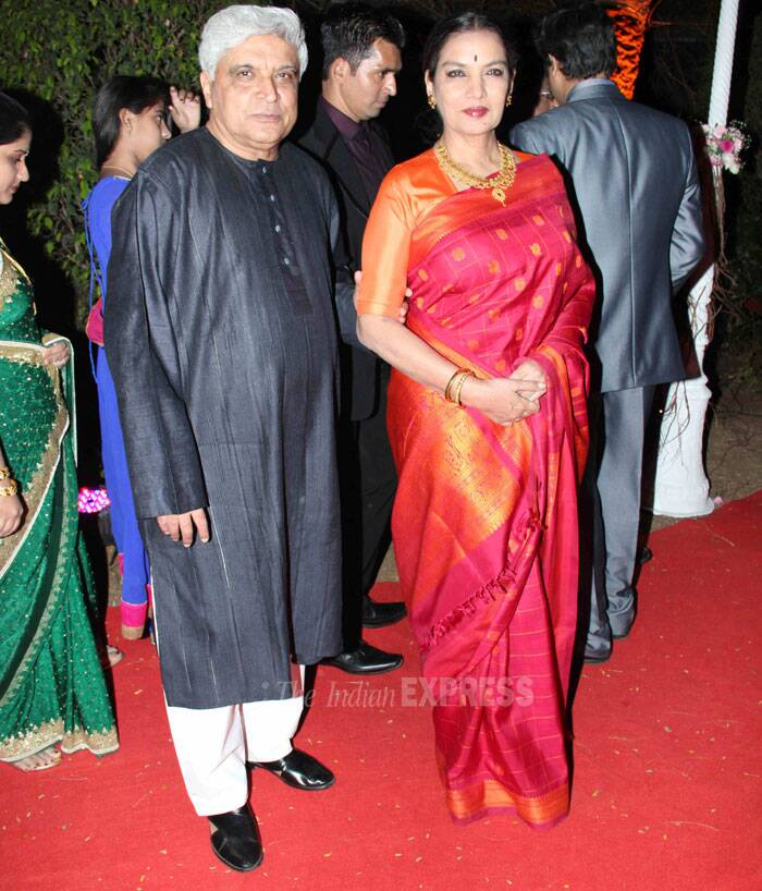 Veteran actress Shabana Azmi was elegant in a lovely pink sari with an orange blouse as she posed along with her lyricist husband Javed Akhtar. (Photo: Varinder Chawla)