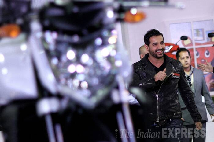 John Abraham, who is known to have a passion for speed and bikes, seemed super excited as he made an entrance. (IE photo: Ravi Kanojia)