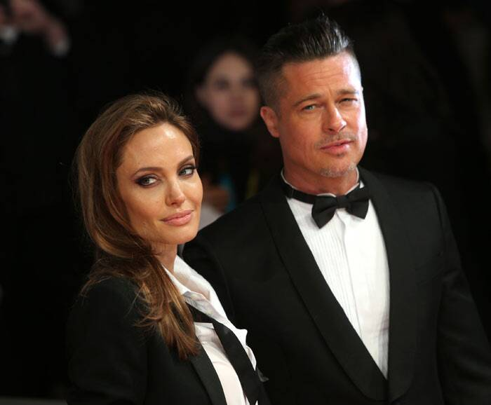 Brad Pitt and fiancee Angelina Jolie looked sexy on the red carpet with their matching tuxedos. (AP)