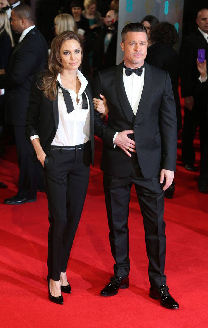 The 38-year-old beauty was accompanied by her handsome 50-year-old beau Brand Pitt, who was suave in a black Valentino blazer. (AP)