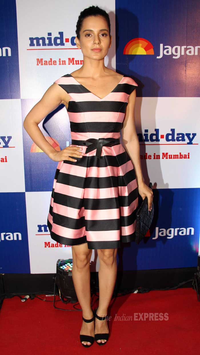 Bollywood's rising new star in the fashion circle Kangana Ranaut was flawless in a striped Topshop dress. The 'Queen' finished off her look with a Dior clutch and black sandals. (Photo: Varinder Chawla)