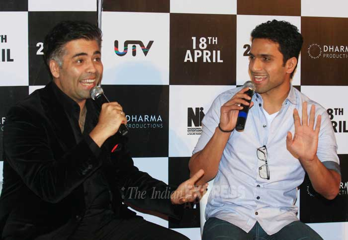 """When asked about rumours of """"something brewing"""" between Alia and director Abhishek Varman, Karan Johar said """"This is news to me. I thought there is something going on between Alia and Arjun"""".<br /> Karan and Abhisek share a laugh. (IE Photo: Amit Chakravarty)"""