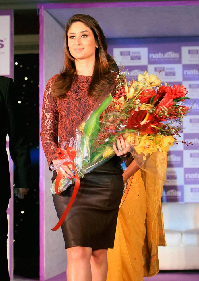 Kareena, who has been appointed brand ambassador of the salon brand, gets a floral welome. (PTI)