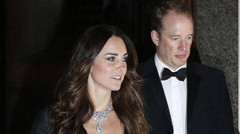 The Duchess of Cambridge was wearing a dark Jenny Packham dress yesterday, but it was the Cartier diamond known as the Nizam of Hyderabad, given to Queen Elizabeth II in 1947 for her wedding to the Duke of Edinburgh, that had tongues wagging. (AP)