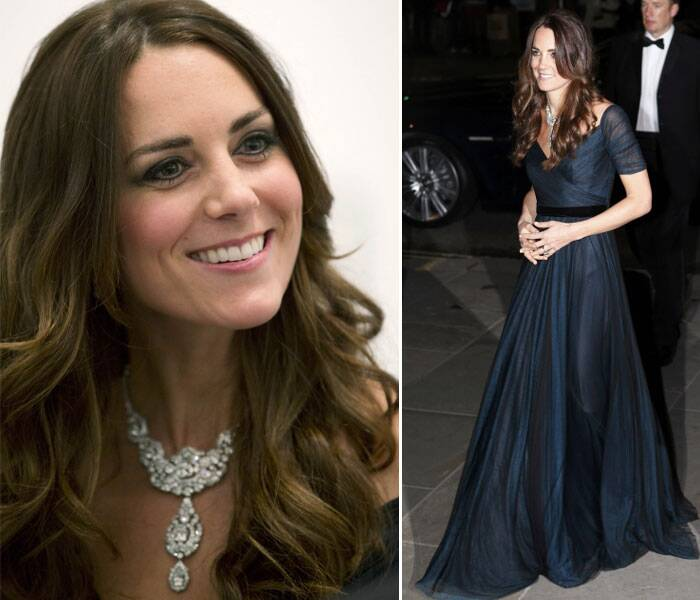 The Duchess of Cambridge was wearing a midnight blue Jenny Packham dress but it was the Cartier diamond known as the 'Nizam of Hyderabad', given to Queen Elizabeth II in 1947 for her wedding to the Duke of Edinburgh, that had tongues wagging. (AP)