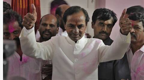 K. Chandrashekar Rao shows a thumbs up sign to supporters after the Indian parliament's lower house passed the bill for the creation of new state called 'Telangana' in New Delhi, India Tuesday, Feb. 18, 2014.