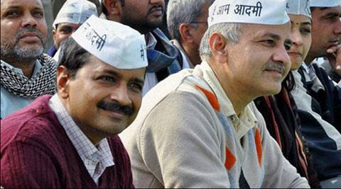 AAP convener Arvind Kejriwal with party leader Manish Sisodia during AAP's public rally in Rohtak on Sunday.