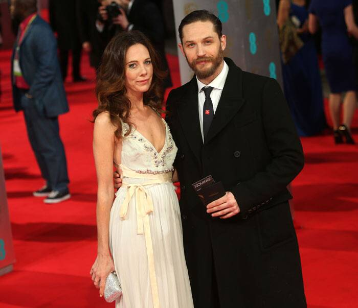 Actor Tom Hardy posed for photographs along with good friend Kelly Marcel.  (AP)