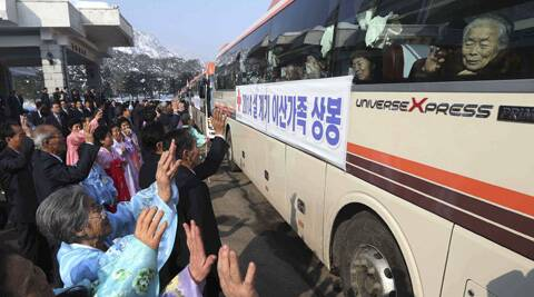 South Korean visitors wave to their North Korean relatives from their bus before returning to South Korea after a family reunion meeting at the Diamond Mountain resort in North Korea. (AP)