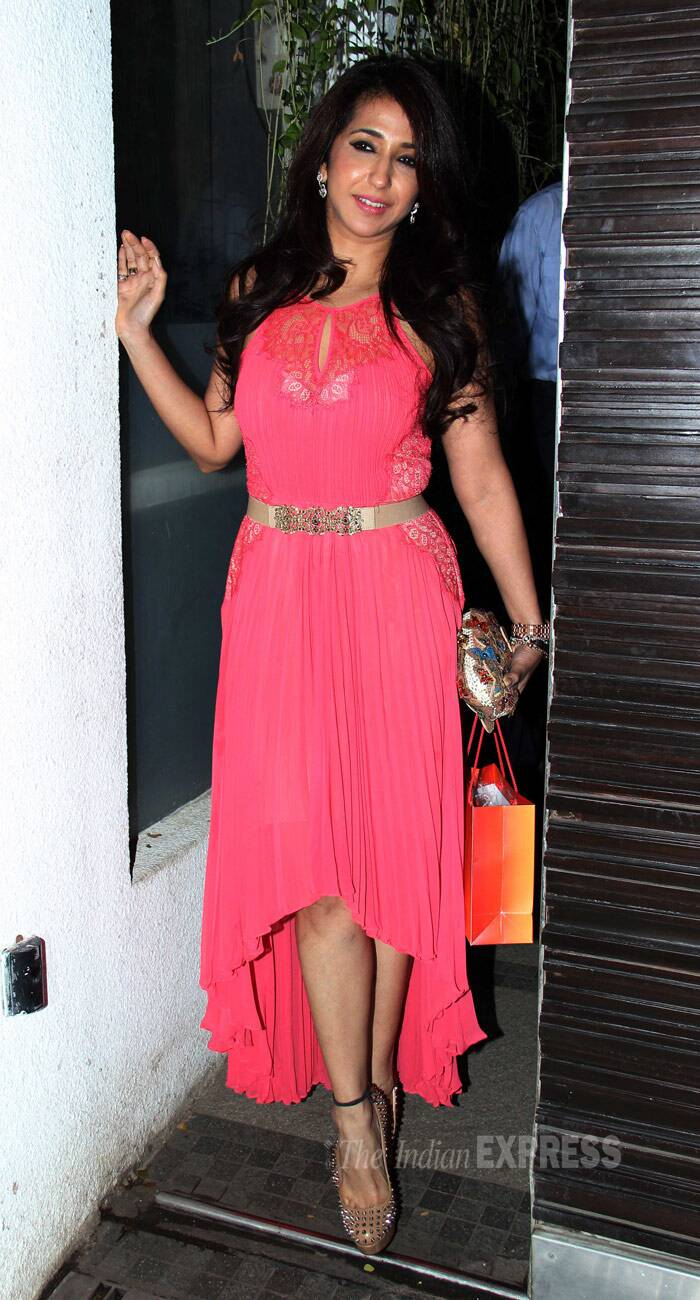 Krishika Lulla of Eros International turned heads in a bright pink dress with a metallic belt and spiked pumps. (Photo: Varinder Chawla)