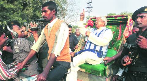 Lalu Prasad takes a rickshaw ride to home after meeting the Speaker in Patna on Tuesday. Ravi S Sahani