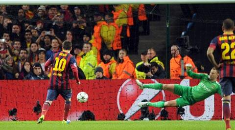 Barcelona's Lionel Messi, left, scores the first goal of the game for his side from a penalty during their Champions League Round of 16 soccer match against Manchester City (AP)