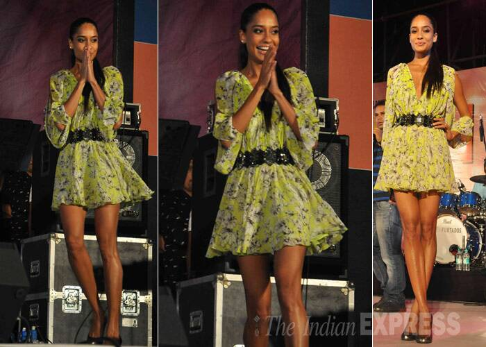 Model-turned-actress Lisa Haydon on the other hand showed off her sexy legs in a printed green dress with a belt. A high ponytail and metallic pumps finished off her look. (Photo: Varinder Chawla)