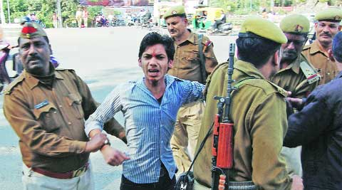 Mohit Mishra, a Hindu Yuva Vahini activitist, bein arrested in Lucknow Saturday.  Vishal Srivastav