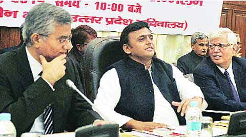 Chief Minister Akhilesh Yadav along with Chief Secretary Javed Usmani at an administrative officers' meet, at Tilak Hall in Lucknow on Friday.