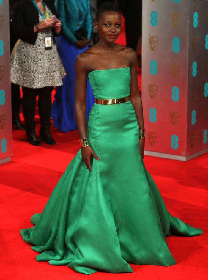 '12 Years A Slave' actress Lupita Nyong'O stole the limelight in an elegant emerald green silk fishtail-hem gown.
