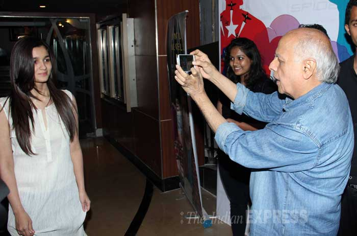 Looks like Mahesh Bhatt too likes Alia's simplicity as he clicks his daughter's pic! (Photo: Varinder Chawla)