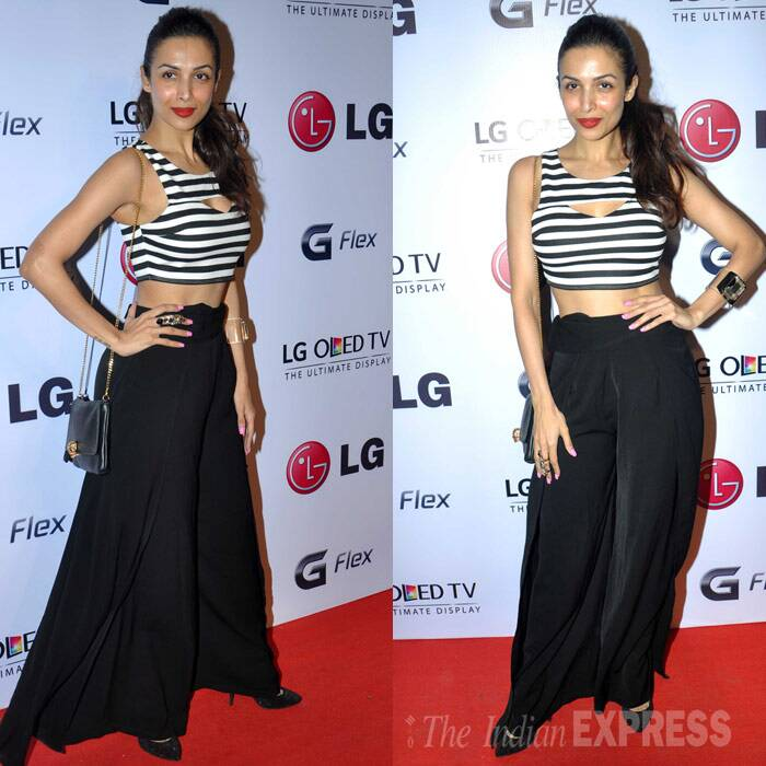 Meahwhile model-turned-producer Malaika Arora Khan sizzled in a monochrome cropped top and black palazzo pants at photographer Atul Kasbekar's exhibition on Thursday (February 6). (Photo: Varinder Chawla)
