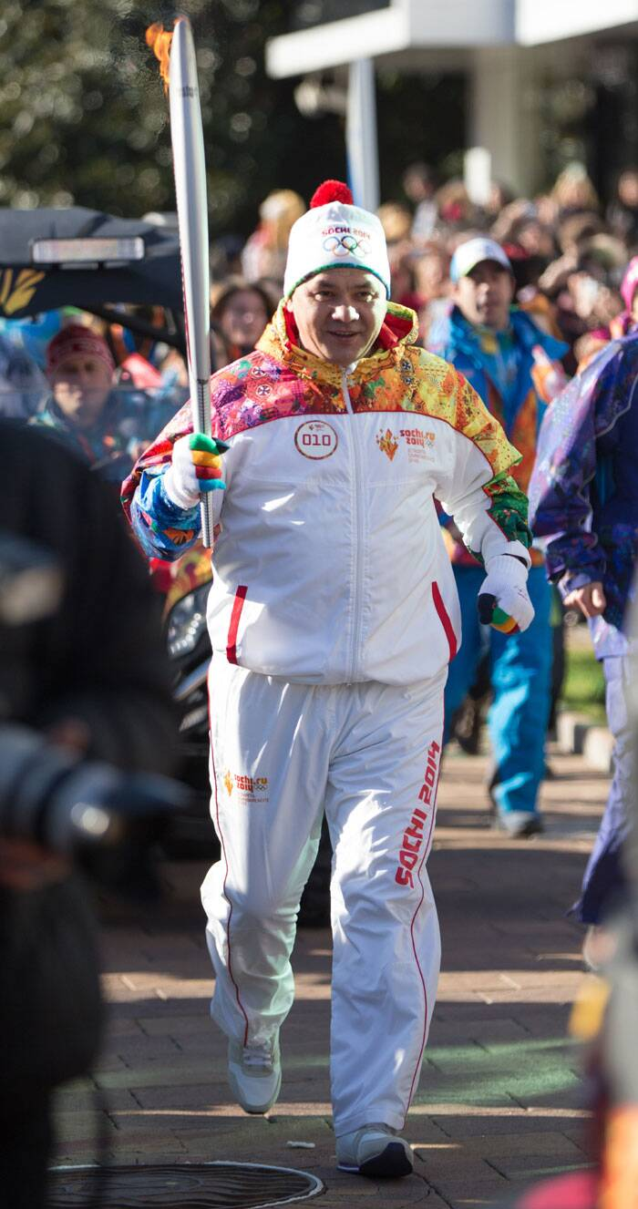 Olympic torch bearer Russian Defense Minister Sergei Shoigu holds an Olympic torch during the torch relay in Sochi, Russia. (AP)