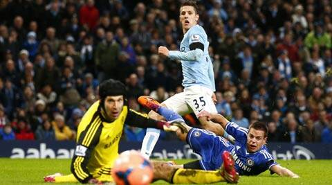 Manchester City's Stevan Jovetic (C) scores a goal as Chelsea's Petr Cech (L) and Cesar Azpilicueta react during their English FA Cup fifth round soccer match at the Etihad Stadium (Reuters)