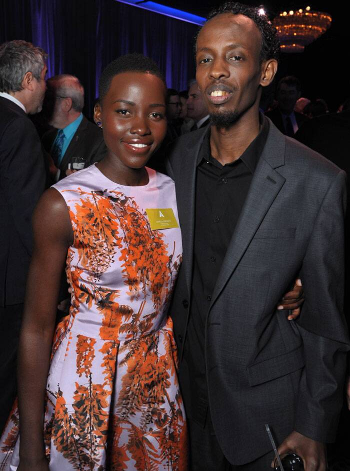 Lupita Nyong'o poses with star Barkhad Abdi at the 86th Oscars Nominees Luncheon. (AP)