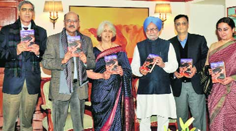 PM Manmohan Singh is presented the first copy of Dr Isher Judge Ahluwalia's book. From left: Siddhesh Inamdar and Krishan Chopra of HarperCollins, Shekhar Gupta, Editor-in-Chief, The Indian Express Group, Dr Ahluwalia, Dr Manmohan Singh, Sunil Jain, Managing Editor, The Financial Express, Vandita Mishra, Opinion Editor, The Indian Express