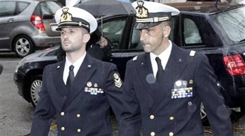 In this March 20, 2013 file photo Italian marines Salvatore Girone, left, and Massimiliano Latorre, arrive at a military prosecutor's office in Rome.