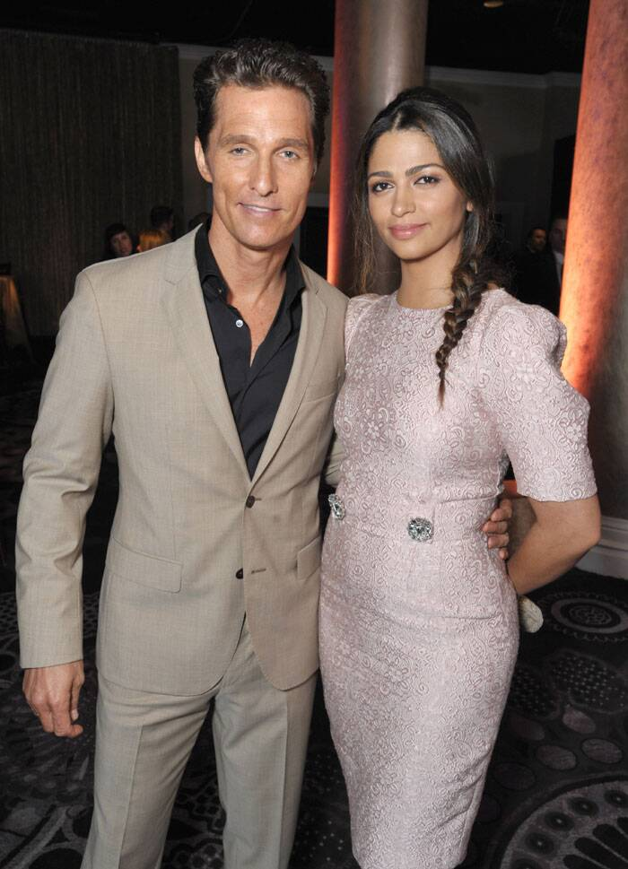 Matthew McConaughey and Camila Alves McConaughey pose for the photogs at the Academy Awards Luncheon. (AP)