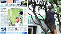 Brendon McCullum, NZ's first triple-centurion, made it to the front page of Daily News, a rare high for cricket in a rugby-crazy nation. A spectator risks a limb to watch McCullum complete his 300 at the Basin Reserve on Tuesday.  (Daksh Panwar)