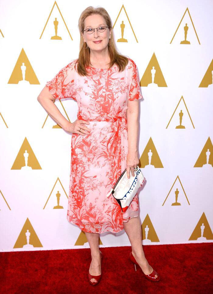 18th time nominee Merly Streep was classy in the white dress with red bamboo print. The actress, nominated for Best Actress for film 'August: Osage County', accessorised her look with red peep toe heels and zippered clutch. (AP)