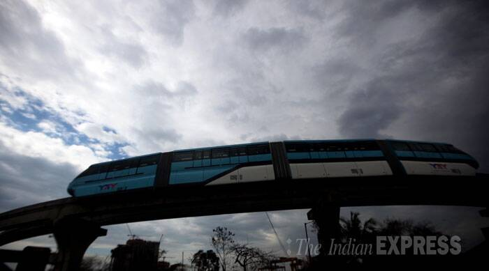 Monorail passes the through Wadala depot filled with people enjoying the joy ride in Mumbai. (IE Photo: Kevin Dsouza)
