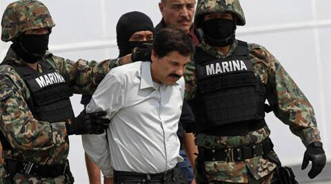 "Joaquin ""El Chapo"" Guzman is escorted to a helicopter in handcuffs by Mexican navy marines. (AP)"