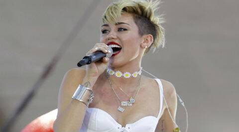Miley Cyrus: On the red carpet the people taking your pictures are yelling at you. and it gets you a little nervous. (Reuters)