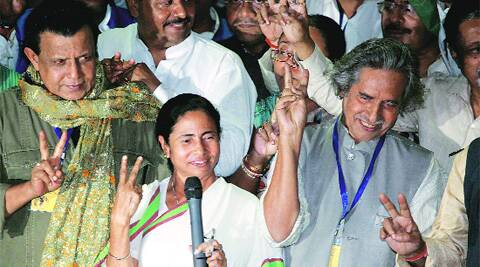Mamata Banerjee with Mithun Chakraborty and Jogen Chowdhury in Kolkata on Friday.
