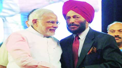 Narendra Modi with Milkha Singh in Surat Sunday. PTI