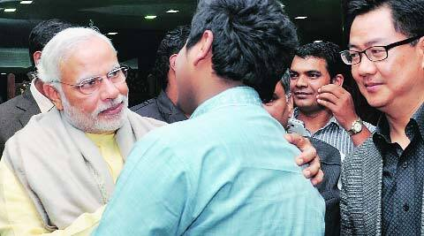 BJP's PM candidate Narendra Modi interacts with students from Northeast in the capital on Wednesday. (Prem Nath Pandey)