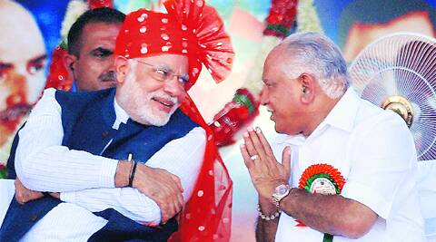 Modi with B S Yeddyurappa at a rally in Davangere, Karnataka, on Tuesday. PTI