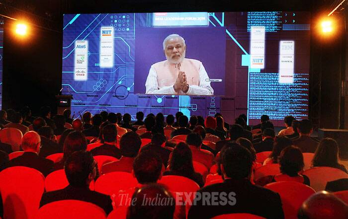 "Describing IT as a change-agent, Modi said IT has the power to transform the country in several ways. ""I see IT as a change-agent. It empowers, connects and can bind isolated parts of the nation and create harmony. IT can join people with governments, bridge the gap between demand and supply, and can bring us closer to knowledge."" (IE Photo: Pradip Das)"