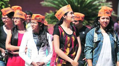 Students of MSU sport 'Modi for PM' caps in Vadodara on Wednesday. (Bhupendra Rana)